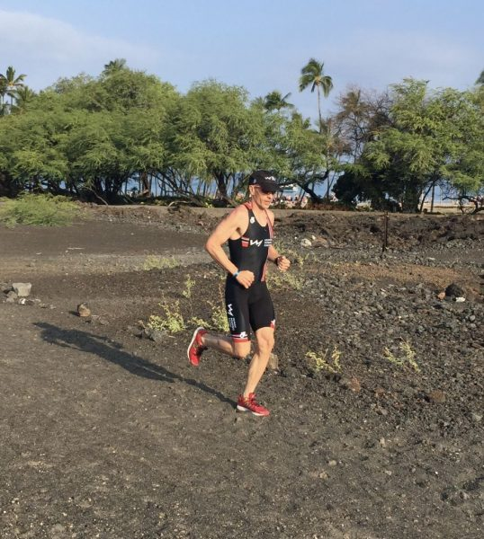 Mike running through lava field in Waikoloa Hawaii with Human Powered Racing race kit on.