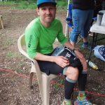Adrian Walton sitting down in a chair after his first 100km ultra marathon