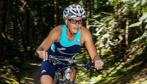 Female Competitor riding mountain bike during XTERRA Victoria triathlon on July 14th 2013