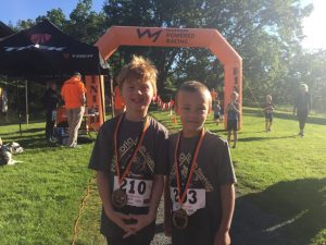 Torsten and Grayson at the finish of the HPR Youth Triathlon West Shore