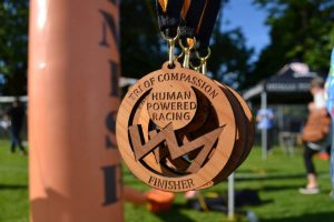 Wooden medals given out at the 2017 Triathlon of Compassion