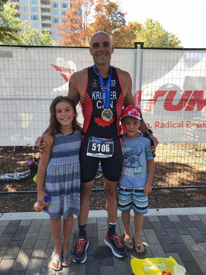 Jay Krieger and his kids at the finish of the ITU Long Course World Championship in Penticton