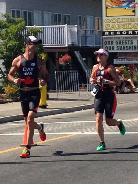 Sandy Wilson and Chris Day running side by side in Penticton at the 2017 ITU Long Course Triathlon World Championship