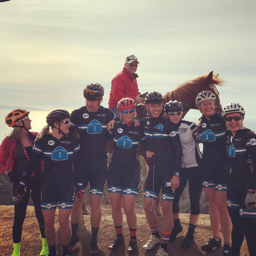Photo at Vertical Bike Camp at top of Piuma Climb with athletes and horse