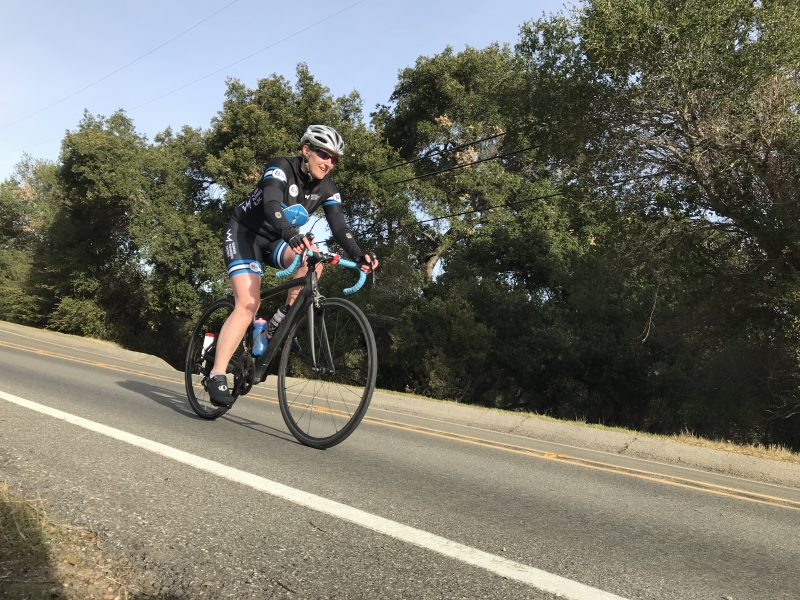 Athlete riding bike at Vertical Camp
