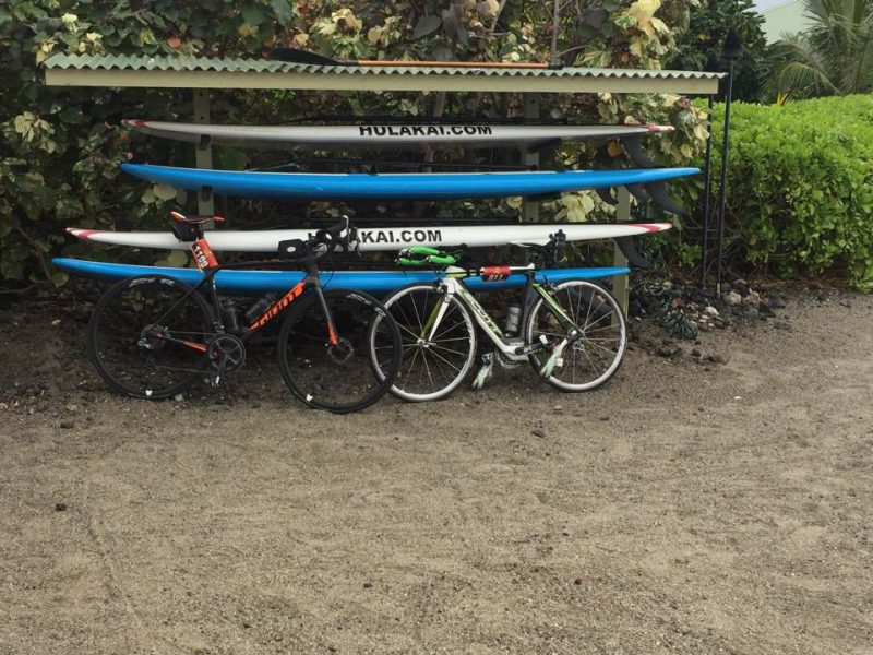 Daphne and Ed's bikes leaning up against surf boards in Hawaii