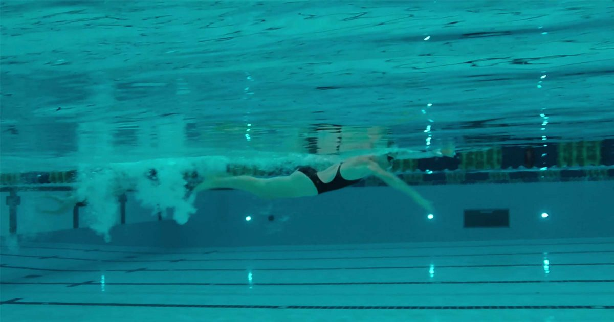 Swimmer does laps in the pool.
