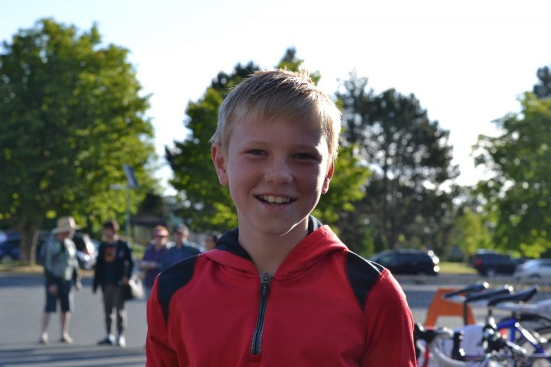 A sibling here to cheer on his brother at the triathlon.