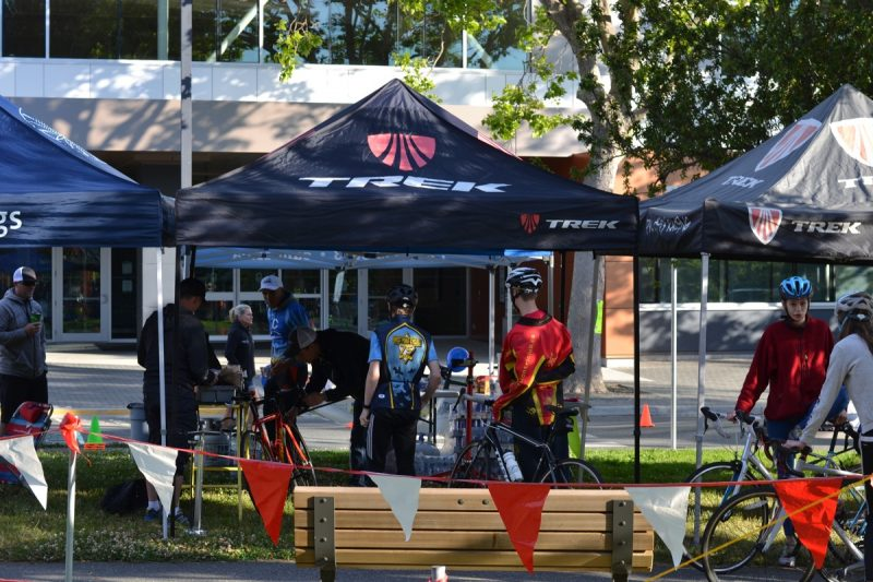 Cyclists get their bicycles tuned at the TREK Pro City tent.