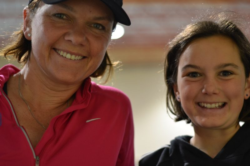 Catherine & Olivia (11) Pickering happy to cheer on Annalise (15).