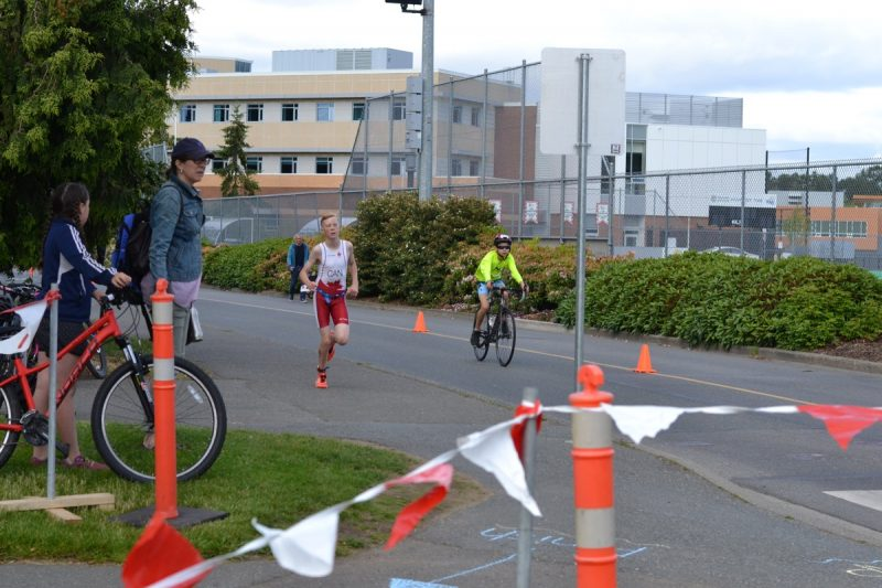 Racers coming into the transition zone at the UVic youth triathlon.