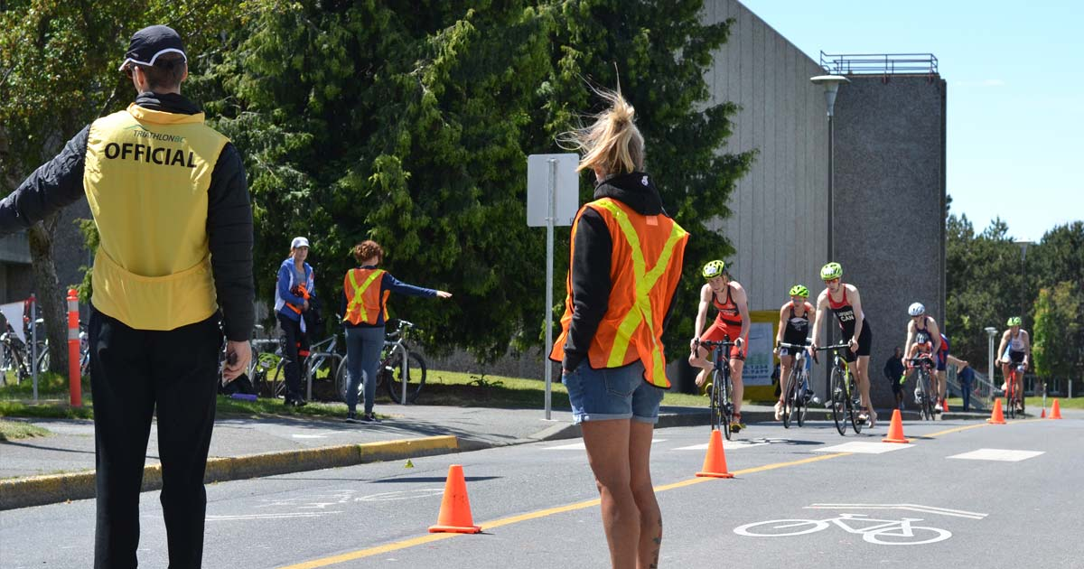 Cyclists approach the dismount transition area at the Victoria Youth Triathlon at UVic.