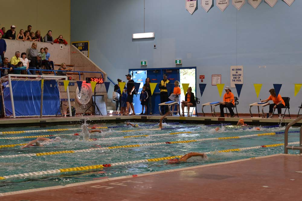 The first swim heat at the Victoria Youth Triathlon at McKinnon gym.