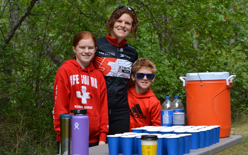 Colette Hopkins and kids volunteering their time at XTERRA Trail Run
