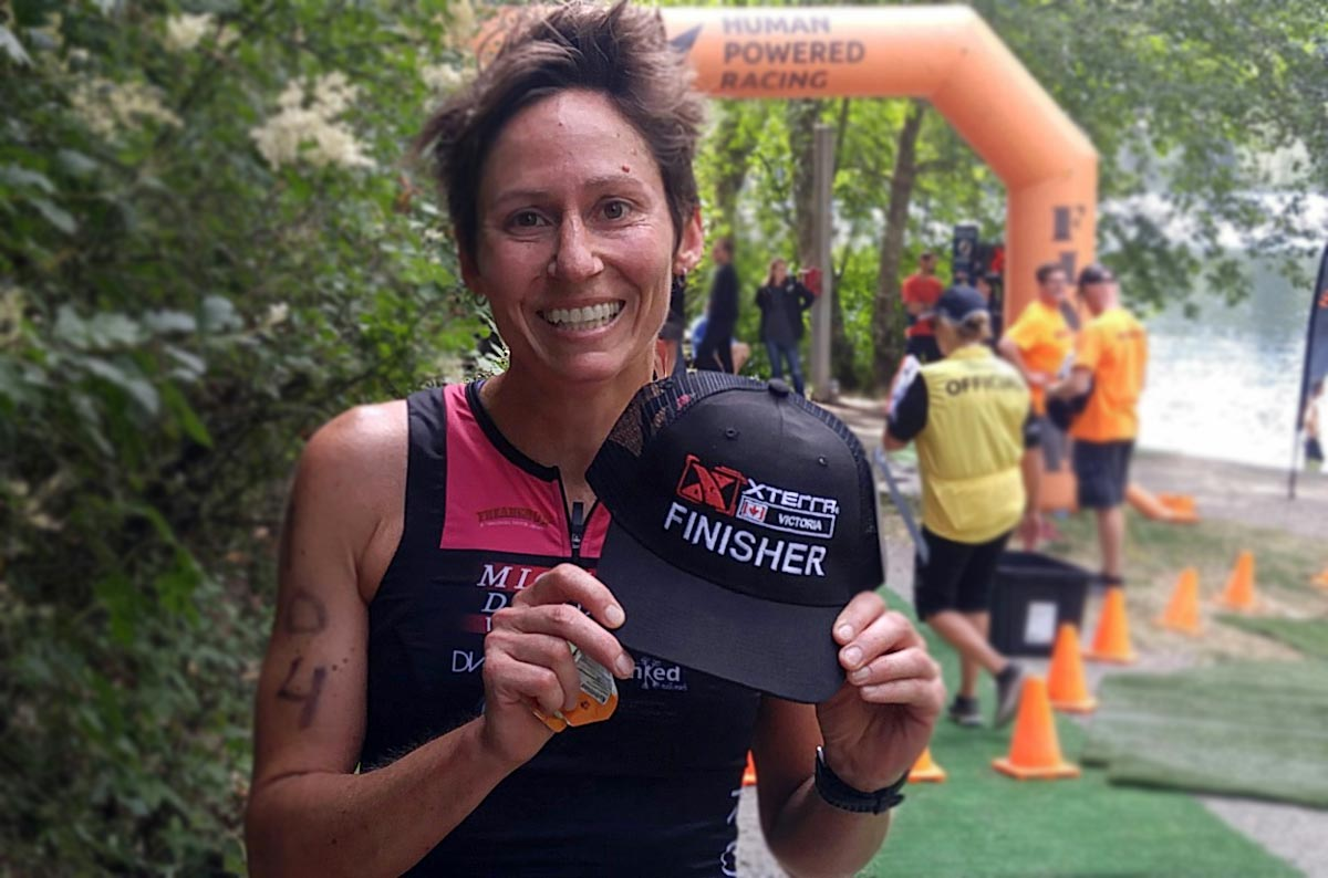 Julie Baker, Number One, at XTERRA Victoria smiles at the finish line.