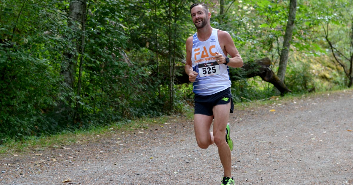 Nick Walker from Frontrunners finishes his first lap of the Victoria XTERRA Trail Run.