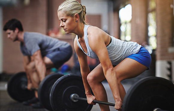 Woman getting ready to do Deadlift