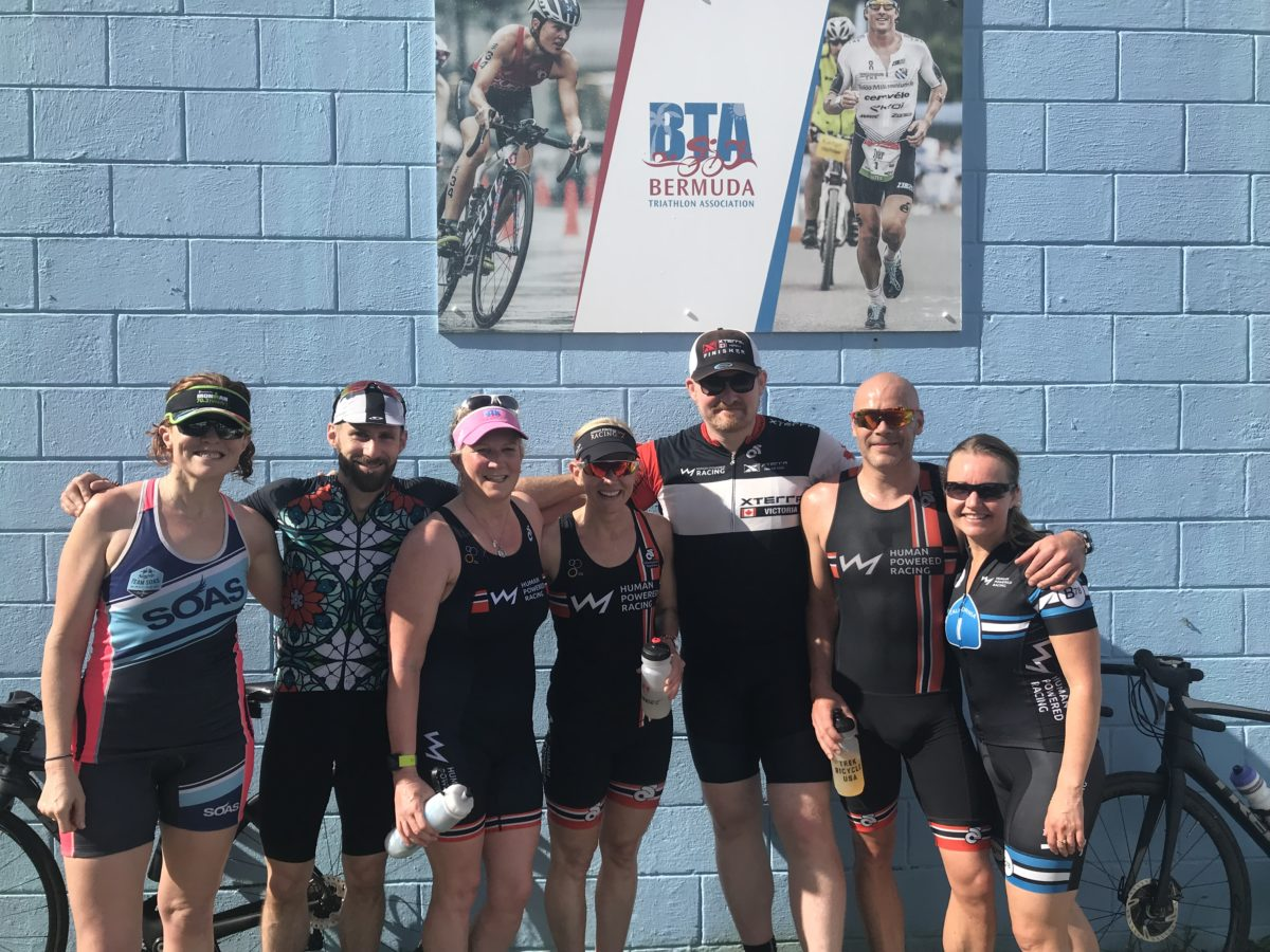 Human Powered Racing athletes pre race in front of Bermuda Triathlon Association Training Hut